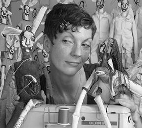 Jody MacDonald in studio with some of her work